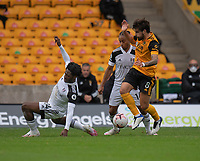 Wolverhampton Wanderers' Ruben Neves (right) holds off the challenge from Fulham's Jean Michael Seri (left) and Bobby Reid (centre)<br /> <br /> Photographer David Horton/CameraSport<br /> <br /> The Premier League - Wolverhampton Wanderers v Fulham - Sunday 4th October 2020 - Molineux Stadium - Wolverhampton<br /> <br /> World Copyright © 2020 CameraSport. All rights reserved. 43 Linden Ave. Countesthorpe. Leicester. England. LE8 5PG - Tel: +44 (0) 116 277 4147 - admin@camerasport.com - www.camerasport.com