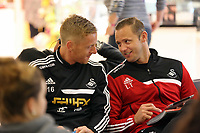 Wednesday 28 August 2013<br /> Pictured L-R: Garry Monk and former player Lee Trundle at Cardiff Airport.<br /> Re: Swansea City FC players and staff en route for their UEFA Europa League, play off round, 2nd leg, against Petrolul Ploiesti in Romania.