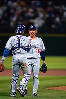 SAN FRANCISCO, CA - Hideo Nomo of the Los Angeles Dodgers celebrates with teammate Mike Piazza after a game against the San Francisco Giants in 1995 at Candlestick Park in San Francisco, California. (Photo by Brad Mangin)