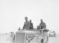 General Rommel bei der 15.  Panzer-Division zwischen Tobruk und Sidi Omar.  General Rommel with the 15th Panzer Division between Tobruk and Sidi Omar.  Libya, Janurary or November 24, 1941.  Sdf. Zwilling. (Foreign Records Seized)<br /> Exact Date Shot Unknown<br /> NARA FILE #:  242-EAPC-6-M713a<br /> WAR & CONFLICT BOOK #:  1016