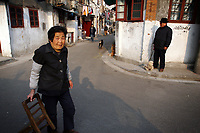 CHINA. Shanghai. Streetscene in the old town. Shanghai is a sprawling metropolis or 15 million people situated in south-east China. It is regarded as the country's showcase in development and modernity in modern China. This rapid development and modernization, never seen before on such a scale has however spawned countless environmental and social problems. 2008