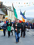 Brendan Walsh leading with the tricolor  at the St Patrick's Day parade in Scariff. Photograph by John Kelly.