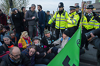 Activists from Extinction Rebellion block several locations around London to demand government action over limate change. 15-4-19