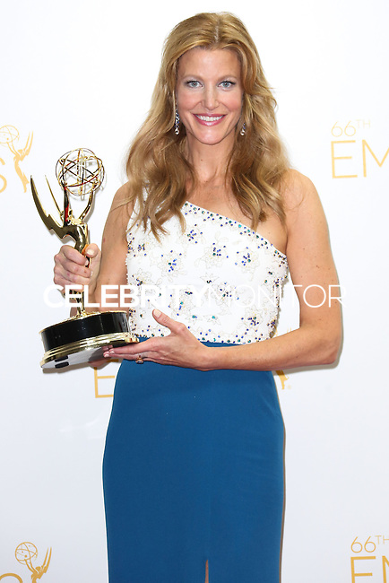 LOS ANGELES, CA, USA - AUGUST 25: Actress Anna Gunn, winner of Outstanding Drama Series Award and Outstanding Supporting Actress in a Drama Series for 'Breaking Bad' poses in the press room at the 66th Annual Primetime Emmy Awards held at Nokia Theatre L.A. Live on August 25, 2014 in Los Angeles, California, United States. (Photo by Celebrity Monitor)