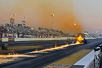 Oct. 14, 2011; Chandler, AZ, USA; NHRA top fuel dragster driver Cory McClenathan has a fuel line break which lights on fire leaving a trail of flames during qualifying at the Arizona Nationals at Firebird International Raceway. Mandatory Credit: Mark J. Rebilas-
