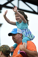 A young Bradenton Marauders fan raises her hands for a ball during a game against the Jupiter Hammerheads on April 19, 2014 at McKechnie Field in Bradenton, Florida.  Bradenton defeated Jupiter 4-0.  (Mike Janes/Four Seam Images)