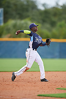 GCL Rays third baseman Luis Arcendo (3) throws to first base during a Gulf Coast League game against the GCL Pirates on August 7, 2019 at Charlotte Sports Park in Port Charlotte, Florida.  GCL Rays defeated the GCL Pirates 5-3 in the second game of a doubleheader.  (Mike Janes/Four Seam Images)