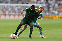 ST PAUL, MN - JULY 24: Dairon Asprilla #27 of the Portland Timbers and Chase Gasper #77 of Minnesota United FC battle for the ball during a game between Portland Timbers and Minnesota United FC at Allianz Field on July 24, 2021 in St Paul, Minnesota.