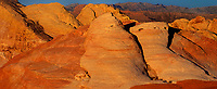 971000003 panoramic view -  low angled sunset light highlights the sandstone formations and red rock mountains giving a three dimensional effect to the scene in valley of fire state park nevada