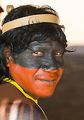 Pará State, Brazil. Aldeia Kokraimoro (Kayapo). Om-Emy Kayapo. Black and red facepaint for the festivities.