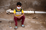 An Iraqi child wears a mask as a preventive measure amid fears of the spread of the novel coronavirus disease (COVID-19) in Baghdad, Iraq, on March 31, 2020. Anas Jomaa