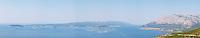 Very Wide panoramic View over the Orebic village town and the Sveti Ilija mountain, dark blue sea towards Korculanski Kanal and the Korcula island. Peljesac Peninsula. Orebic town. Peljesac peninsula. Dalmatian Coast, Croatia, Europe.