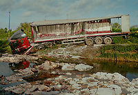THe scene of an HGV accident near Wisbech, Cambridgehsire which deposited hundred of bags of flour bound for Tesco in a river.