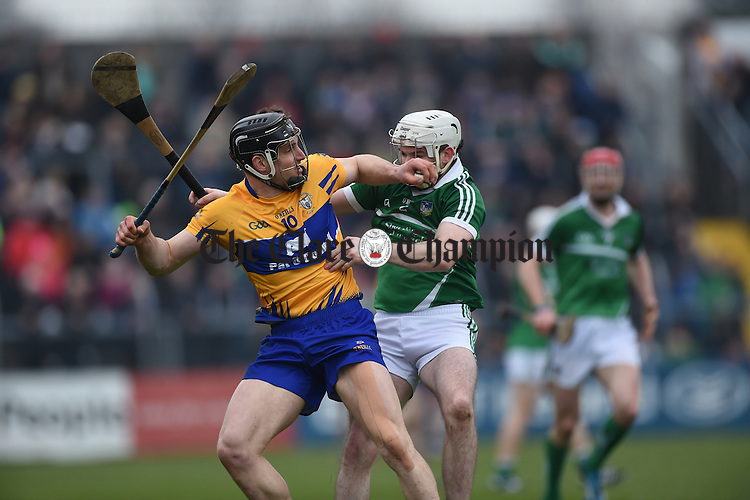John Conlon of Clare in action against Tom Condon of Limerick during their Div. 1b Round 5 game in Cusack park. Photograph by John Kelly.