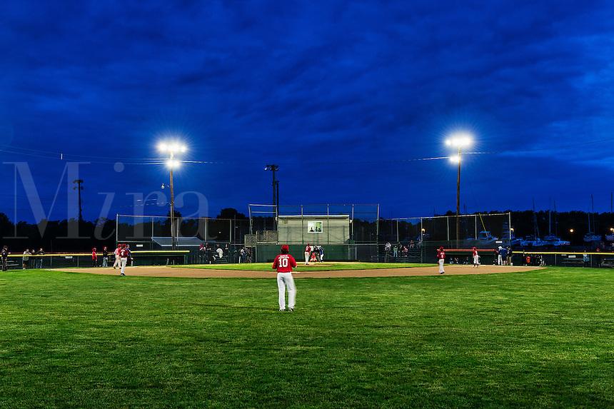 Little League baseball game at night.