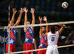 Capellan Lopez, with the Dominican Republic, hits at a wall of Puerto Rico blockers, from left, Maurice Torres, Josue Nunez and Eddie Rivera during the Pan America Cup at the Reno Events Center in Reno, Nev., on Monday, Aug. 17, 2015. <br /> Photo by Cathleen Allison