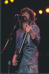 Brad Delp of Boston performing live at The Forum in Los Angeles , Ca July 1987