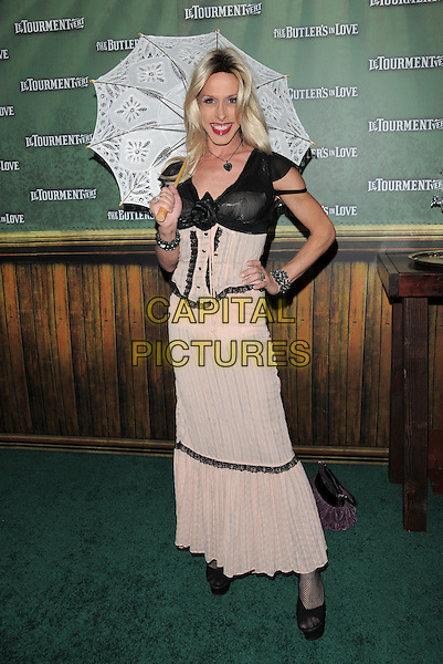 ALEXIS ARQUETTE .The Butler's in Love L.A. Premiere held at The Mann's Chinese Theatre in Hollywood, California on .June 23rd, 2008   .full length pink dress umbrella black trim edges shoes sheer dress-up costume cross-dresser hand on hip corset .CAP/DVS.©Debbie VanStory/Capital Pictures.