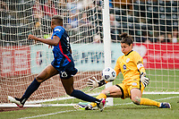 TACOMA, WA - JULY 31: Tziarra King #23 of the OL Reign takes a shot on goal against Michelle Betos #1 of Racing Louisville FC during a game between Racing Louisville FC and OL Reign at Cheney Stadium on July 31, 2021 in Tacoma, Washington.