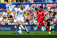 Mike van der Hoorn of Swansea City battles with João Carvalho of Nottingham Forest during the Sky Bet Championship match between Swansea City and Nottingham Forest at the Liberty Stadium in Swansea, Wales, UK. Saturday 14 September 2019
