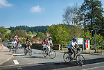 Germany, Baden-Wuerttemberg, Tauber Valley, Wertheim, district Bronnbach: cyclists passing a railroad crossing | Deutschland, Baden-Wuerttemberg, Taubertal, Wertheim, Ortsteil Bronnbach: Radfahrer ueberqueren Bahnuebergang