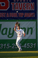 Auburn Doubledays left fielder Nick Banks (34)  catches a fly ball during a game against the Williamsport Crosscutters on June 25, 2016 at Falcon Park in Auburn, New York.  Auburn defeated Williamsport 5-4.  (Mike Janes/Four Seam Images)