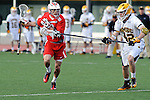 Baltimore, MD - March 3:  Defensemen Ian Gray #42 of the UMBC Retrievers checks Midfielder Brent Adams #8 of the Fairfield Stags during the Fairfield v UMBC mens lacrosse game at UMBC Stadium on March 3, 2012 in Baltimore, MD.