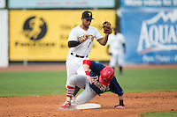 Luke Doyle (18) of the Johnson City Cardinals slides into second base as Trae Arbet (7) of the Bristol Pirates catches a throw at Boyce Cox Field on July 7, 2015 in Bristol, Virginia.  The Cardinals defeated the Pirates 4-1 in game one of a double-header. (Brian Westerholt/Four Seam Images)