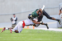 SMU defensive back Ajee Montes (10) tackles Baylor wide receiver Jay Lee (4) during the first half of NCAA Football game at McLean Stadium, Sunday, August 31, 2014 in Waco, Tex. Baylor defeated SMU 45-0. (Mo Khursheed/TFV Media via AP Images)