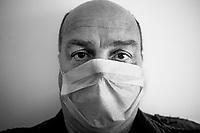 Switzerland. Canton Ticino. Lugano. Self-Portrait. Due to the spread of the coronavirus (also called Covid-19), the mask is compulsory in the doctor's waiting room. 18.05.2020 © 2020 Didier Ruef