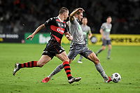 6th April 2021; Bankwest Stadium, Parramatta, New South Wales, Australia, Australian A League football, Western Sydney Wanderers versus Central Coast Mariners; Gianni Stensness of Central Coast Mariners stretches for the ball as Mitch Duke of Western Sydney Wanderers approaches