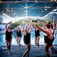The Aquadettes practice a routine out of the water at Laguna Woods, California. The Aquadettes are a group of women ageing from their early 60s upwards who meet to practice synchronised swimming. Every year, they practice together, they make costumes together, they swim together, and at the end, they perform together.