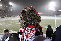 Under a steady snowfall, a USA fan watches the USA Men's National Team's World Cup Qualifier against Costa Rica  at Dick's Sporting Good Park in Commerce City, CO on March 22, 2013.