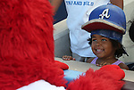 Archie plays with a fan at Greater Nevada Field in Reno, Nev., on Sunday, July 17, 2016.<br />