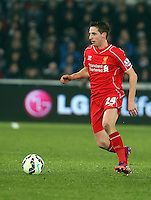 SWANSEA, WALES - MARCH 16: Joe Allen of Liverpool in action during the Premier League match between Swansea City and Liverpool at the Liberty Stadium on March 16, 2015 in Swansea, Wales