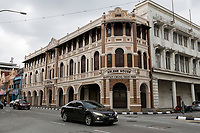 Ipoh, Malaysia.   Chung Thye Phin Building, 1909, now Arlene House. Street Scene and Local Architecture.