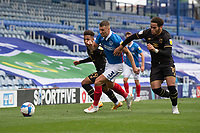 Portsmouth's Lee Brown (centre) under pressure from Milton Keynes Dons' Matthew Sorinola (left) and Sam Nombe (right) <br /> <br /> Photographer David Horton/CameraSport<br /> <br /> The EFL Sky Bet League One - Portsmouth v Milton Keynes Dons - Saturday 10th October 2020 - Fratton Park - Portsmouth<br /> <br /> World Copyright © 2020 CameraSport. All rights reserved. 43 Linden Ave. Countesthorpe. Leicester. England. LE8 5PG - Tel: +44 (0) 116 277 4147 - admin@camerasport.com - www.camerasport.com