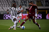 Moise Kean of Juventus FC and Gleison Bremer of Torino Calcio compete for the ball during the Serie A 2021/2022 football match between Torino FC and Juventus FC at Stadio Olimpico Grande Torino in Turin (Italy), October 2nd, 2021. Photo Federico Tardito / Insidefoto