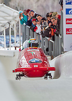 9 January 2016: Italian pilot Simone Bertazzo leads his 4-man team as they cross the finish line after their second run of the day at the BMW IBSF World Cup Bobsled Championships at the Olympic Sports Track in Lake Placid, New York, USA. Bertazzo's team came in 11th for the day, with a 2-run combined time of 1:50.99. Mandatory Credit: Ed Wolfstein Photo *** RAW (NEF) Image File Available ***