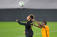 CARSON, CA - OCTOBER 28: Danny Musovski #16 of the LAFC heads a ball during a game between Houston Dynamo and Los Angeles FC at Banc of California Stadium on October 28, 2020 in Carson, California.