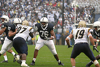 State College, PA - 9/2/2006 - Penn State offensive linemen Gerald Cadogan (76) and A.Q. Shipley (57) provide blocking for quarterback Anthony Morelli (14) in the game against the University of Akron on September 2, 2006, at Beaver Stadium.  The Nittany Lions defeated the Zips 34-16 on a soggy day...Photo credit:  Joe Rokita / JoeRokita.com