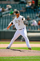 A.J. Achter (31) of the Salt Lake Bees delivers a pitch to the plate against the El Paso Chihuahuas in Pacific Coast League action at Smith's Ballpark on July 10, 2016 in Salt Lake City, Utah. El Paso defeated Salt Lake 11-2. (Stephen Smith/Four Seam Images)