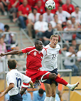Cyd Gray of Trinidad almost gets as high as Peter Crouch of England. England defeated Trinidad & Tobago 2-0 in their FIFA World Cup group B match at Franken-Stadion, Nuremberg, Germany, June 15 2006.