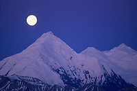 Full moon over mt Brooks, the Alaska mountain range, Denali National Park, Alaska
