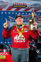 Sep 2, 2019; Clermont, IN, USA; NHRA top fuel driver Doug Kalitta poses for a portrait as he celebrates after winning the US Nationals at Lucas Oil Raceway. Mandatory Credit: Mark J. Rebilas-USA TODAY Sports