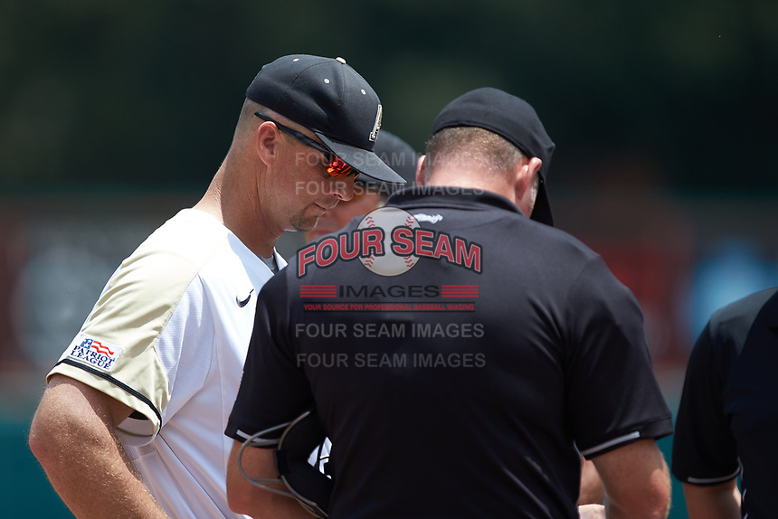 Army Black Knights head coach Jim Foster meets with the home plate umpire Mike Jarboe prior to the game against the North Carolina State Wolfpack at Doak Field at Dail Park on June 3, 2018 in Raleigh, North Carolina. The Wolfpack defeated the Black Knights 11-1. (Brian Westerholt/Four Seam Images)