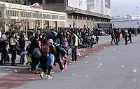 Pictured: Hundreds of migrants at the port Friday 26 February 2016<br />Re: Hundreds of refugees that crossed the border from Turkey to the Greek islands, have arrived at the port of Piraeus near Athens, Greece