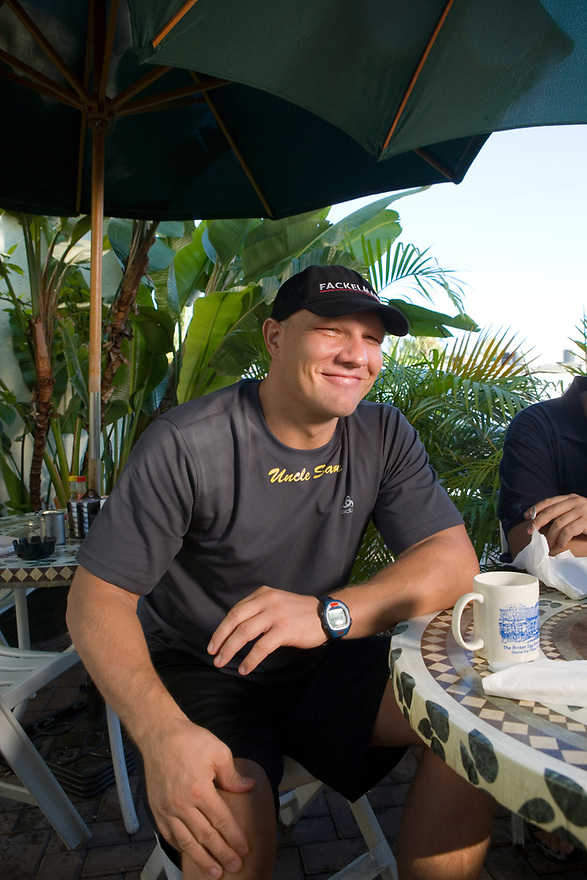 German Heavyweight Boxer Axel Schultz eats breakfast at the Broken Egg Restaurant on Siesta Key near Sarasota, Florida for his comeback fight in Germany in November. Photographed September 5, 2006 for Der Spiegel magazine. His manger is Wolfram Koehler (in blue)