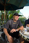 German Heavyweight Boxer Axel Schultz eats breakfast at the Broken Egg Restaurant on Siesta Key near Sarasota, Florida for his comeback fight in Germany in November. Photographed September 5, 2006 for Der Spiegel magazine. His manger is Wolfram Koehler (in blue)