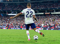 NASHVILLE, TN - SEPTEMBER 5: DeAndre Yedlin #22 of the United States passes the ball during a game between Canada and USMNT at Nissan Stadium on September 5, 2021 in Nashville, Tennessee.